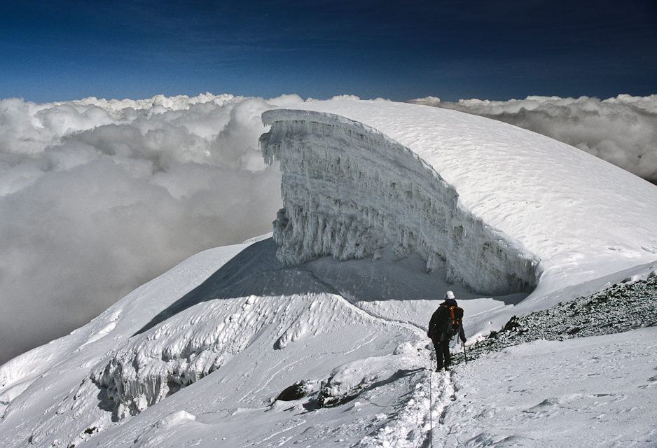 Susan Kaspari skirts an ice cliff high on Cotopaxi (19,347 ft.), Ecuador