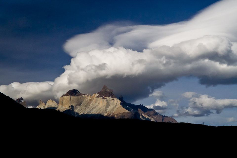 High winds blow clouds over the jagged tops of Los Cuernos, Torres del Paine, Patagonia